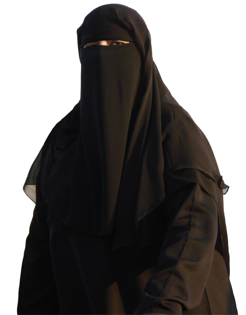 Many women in Saudi Arabia still wear the traditional abaya with full head and face covering, although some women choose now to leave off the face cover